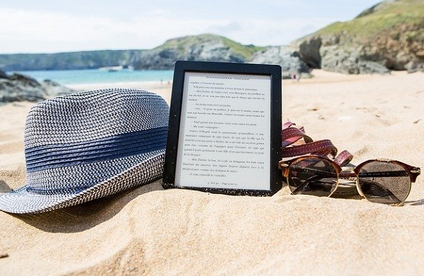 iPad or Kindle - choose a kindle if you like reading outside